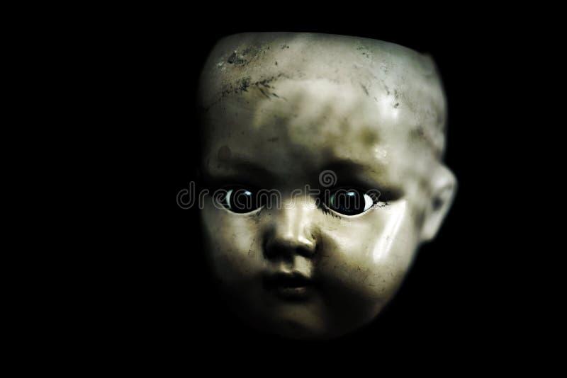 在黑暗的蠕动的玩偶 免版税图库摄影