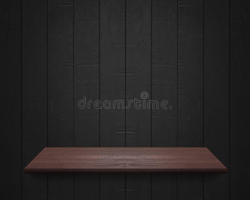在黑木墙壁背景的空的架子 库存照片