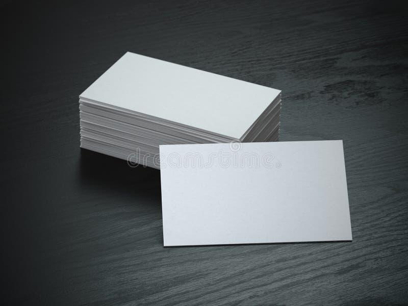 在黑木桌背景的白色空白的名片大模型 皇族释放例证