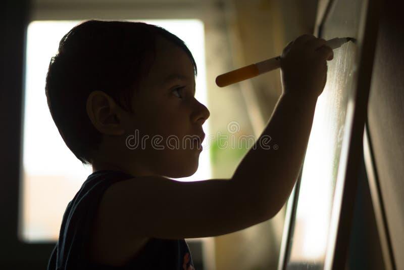 在黑板的儿童文字 免版税库存照片