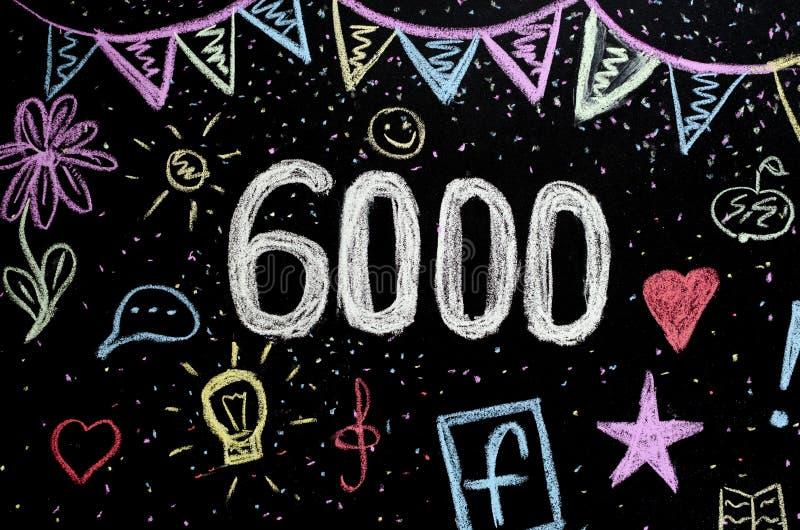 6 000在黑板的粉笔画 库存照片