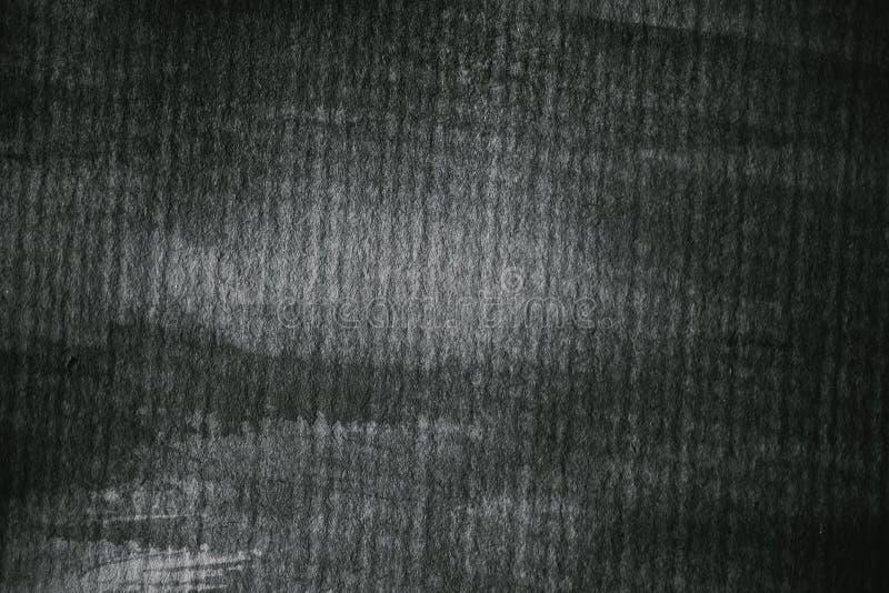 在黑白的织地不很细纸 灰色绘了纸纹理和背景设计的 抽象灰色纹理特写镜头视图  免版税库存图片