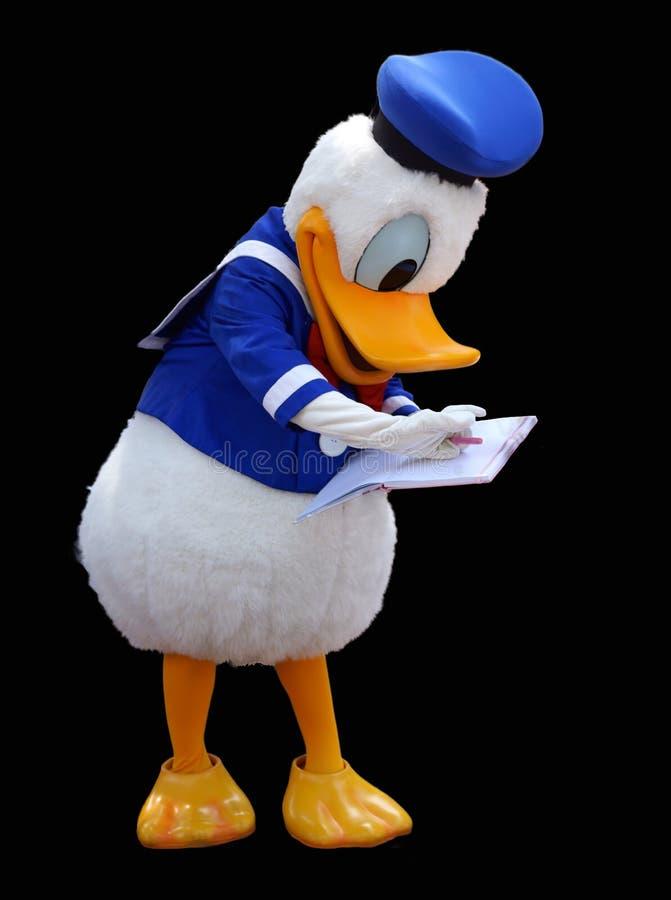 在黑背景关闭的唐老鸭服装 库存图片