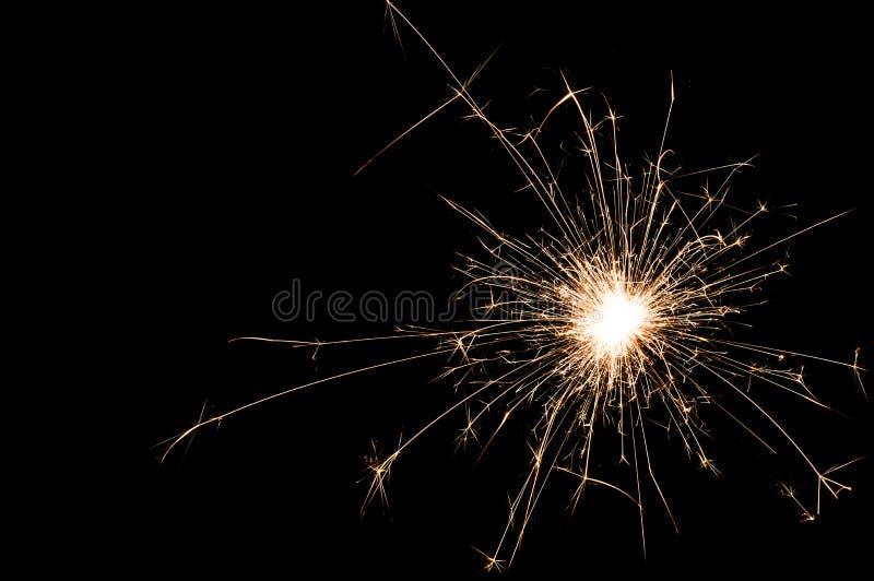 在黑背景的一个小新年闪烁发光物 图库摄影