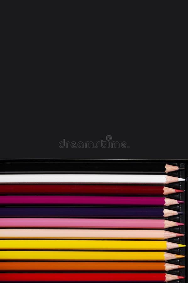 在黑背景的多色铅笔 艺术和创造性概念 图库摄影