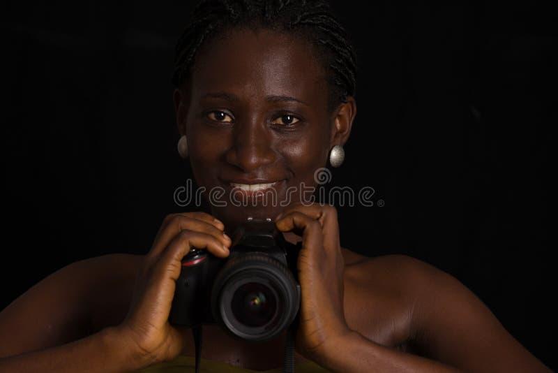 一个女孩的画象有照相机的 库存照片