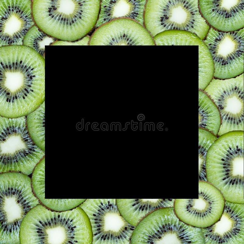 在黑背景的果子切片 免版税库存照片