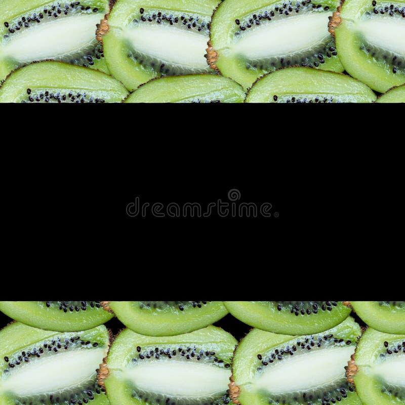 在黑背景的果子切片 图库摄影