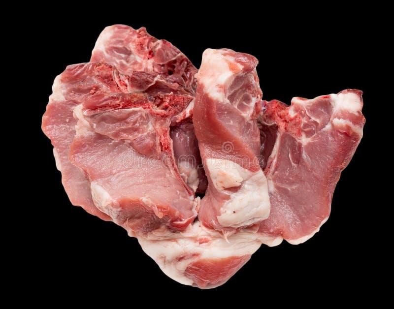 在黑背景的猪肉 库存照片