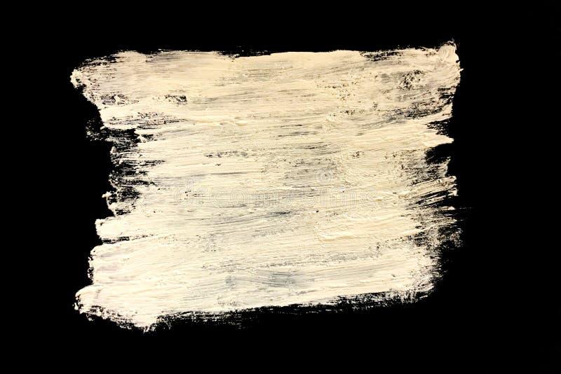 在黑背景的白色油漆,纹理 库存图片