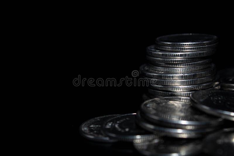 在黑背景的硬币 图库摄影