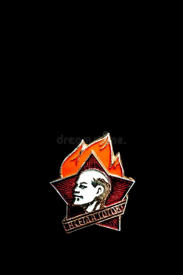 在黑背景的老苏联徽章,孤立 免版税库存图片