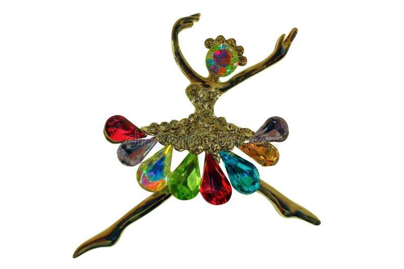 在黑背景的被隔绝的金黄别针以芭蕾舞女演员的形式 库存图片