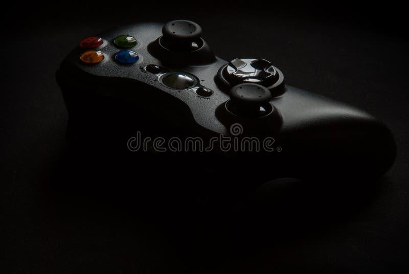 在黑背景的Gamepad 库存照片