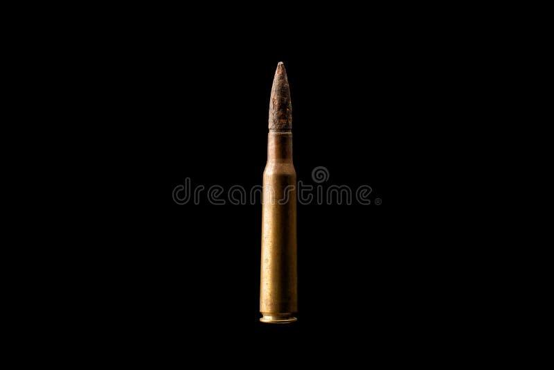 在黑背景隔绝的大子弹 库存照片