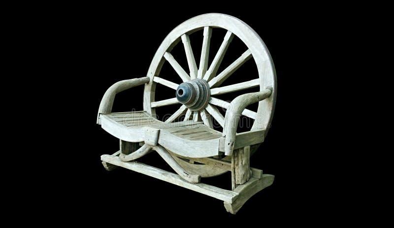 在黑背景隔绝的木椅子长凳 免版税库存照片