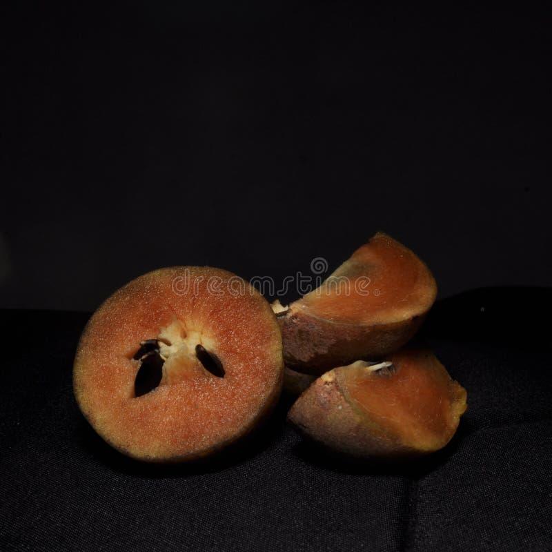 在黑背景隔绝的果实果子 库存图片