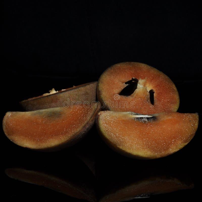 在黑背景隔绝的果实果子 免版税图库摄影