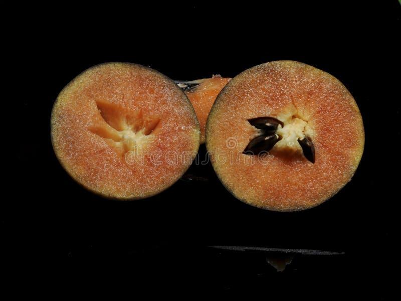 在黑背景隔绝的果实果子 库存照片