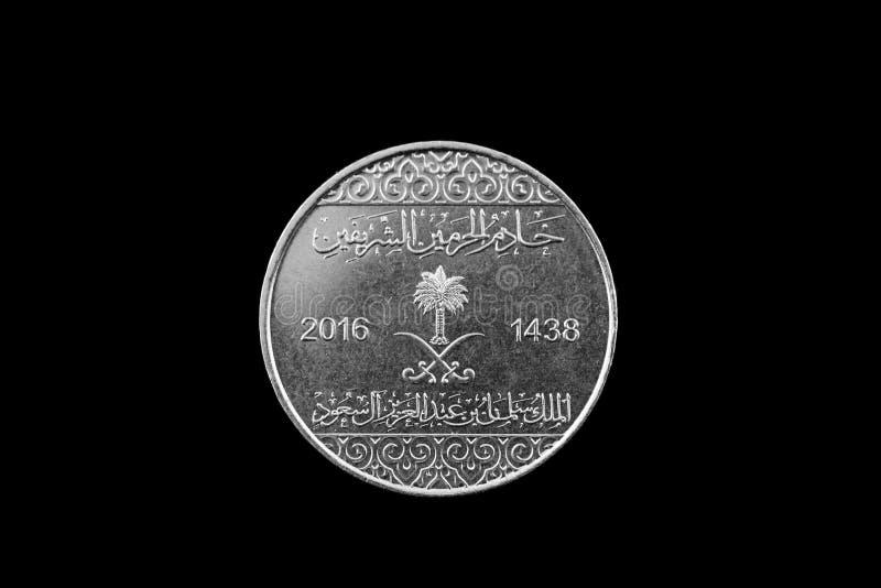 在黑背景隔绝的沙特阿拉伯银币 免版税库存图片