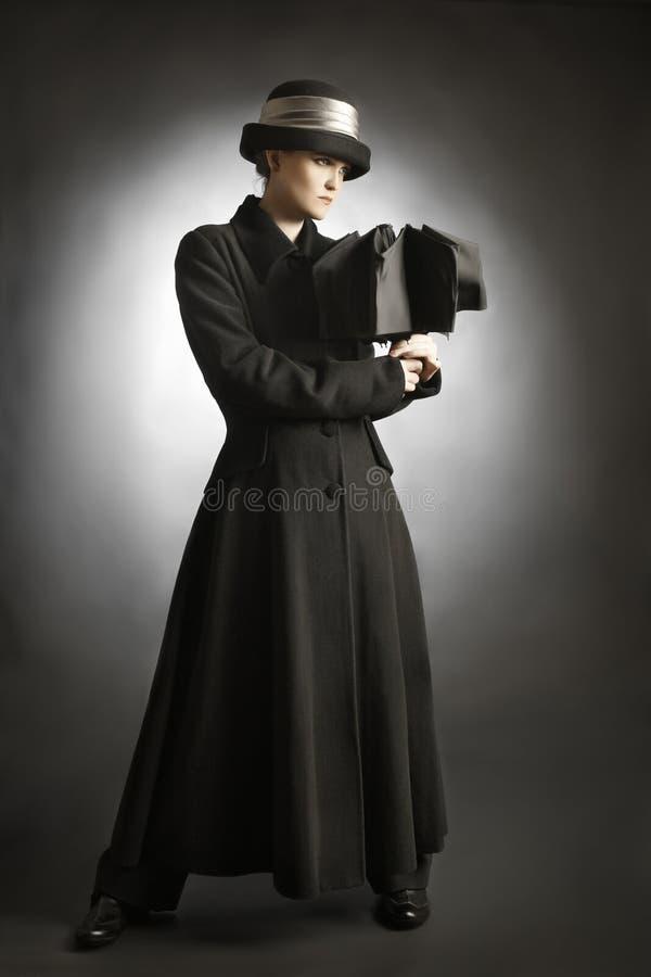 在黑色外套的时装模特儿 免版税库存照片