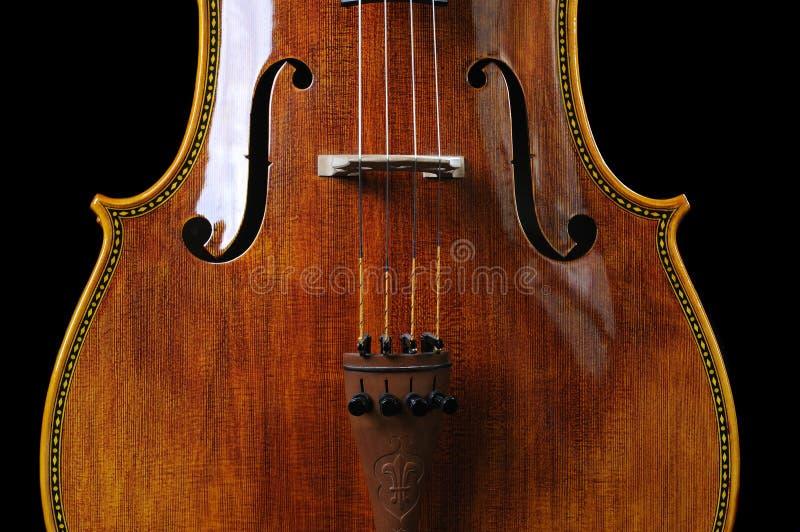 在黑色背景的大提琴 免版税库存照片