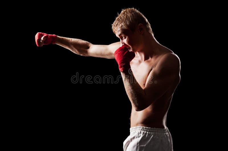 在黑色背景的战斗机拳击 图库摄影