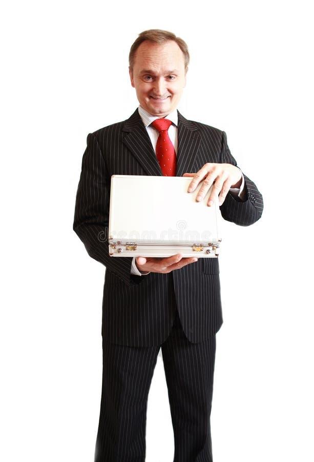 在黑色诉讼的生意人惊奇与礼品 免版税库存照片