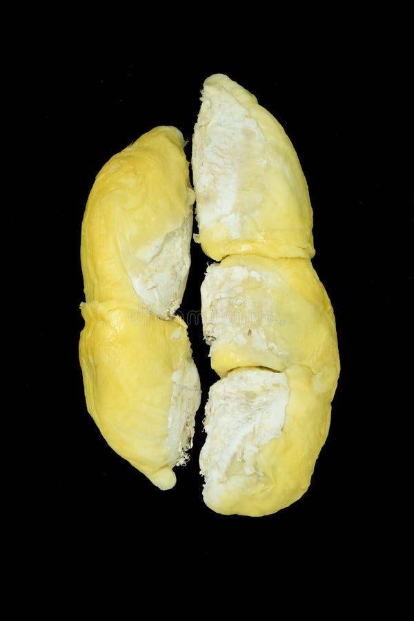 在黑色隔绝的黄色留连果 免版税库存照片