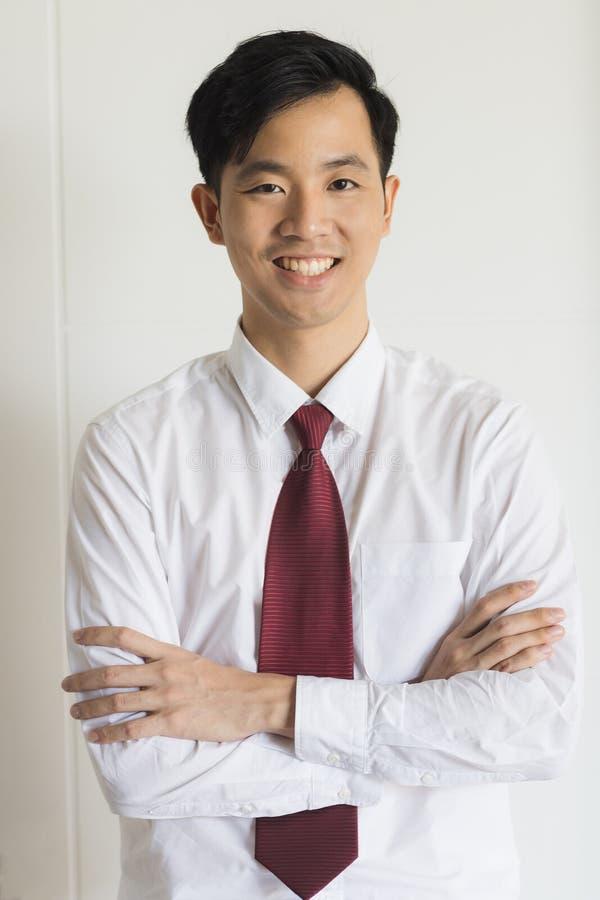 在黑衣服身分的年轻亚洲商人 免版税图库摄影