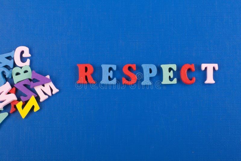 在从五颜六色的abc字母表块木信件组成的蓝色背景,广告文本的拷贝空间的尊敬词 免版税图库摄影