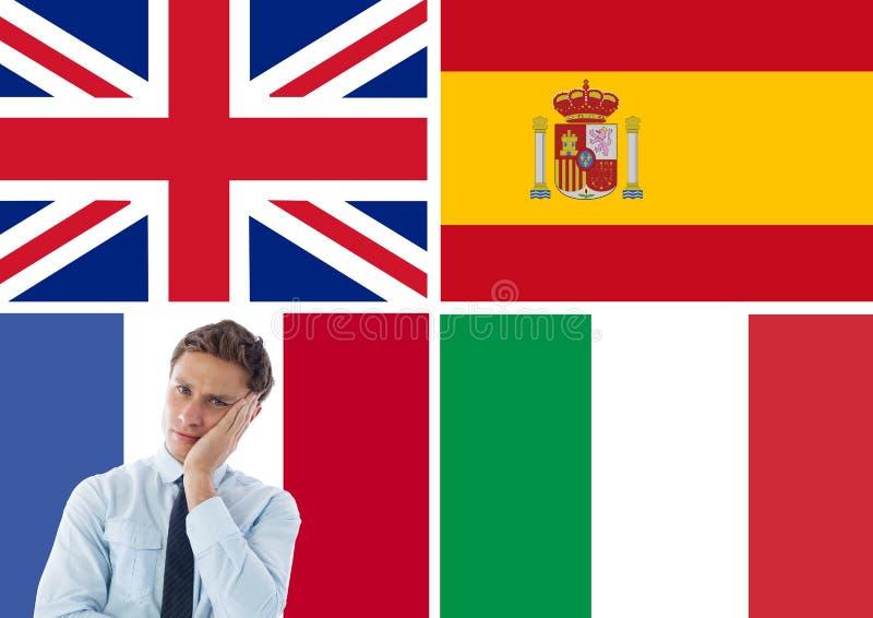 在年轻商人认为附近的主要语言旗子 库存照片
