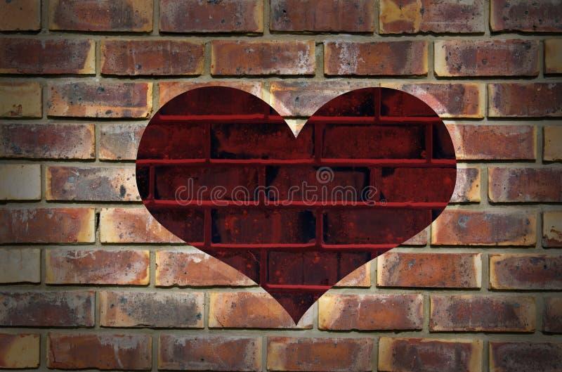 在织地不很细墙壁上的红色心脏 库存图片