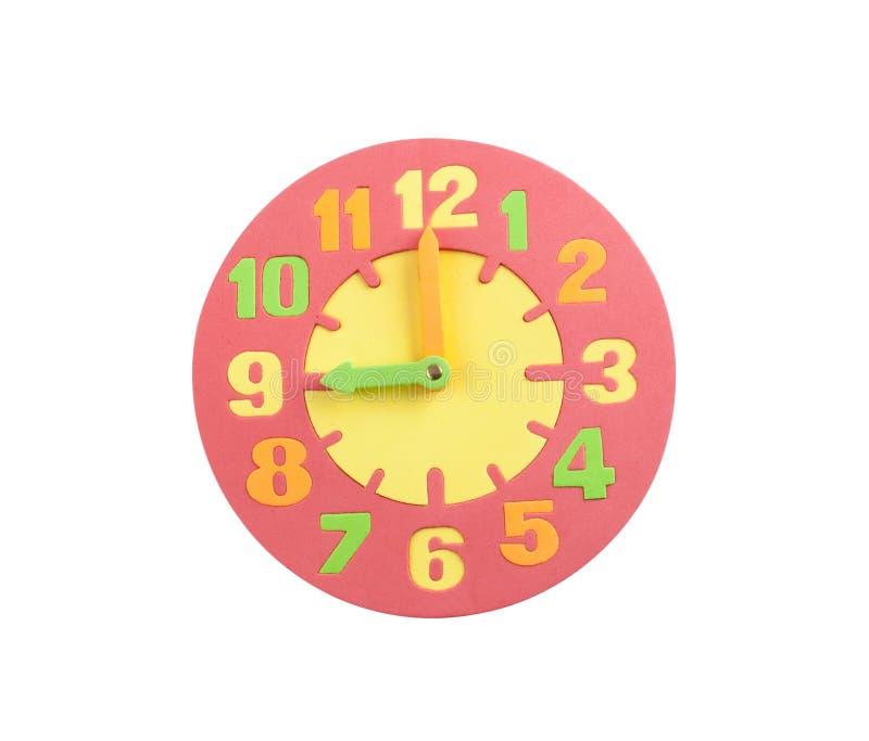 在织地不很细泡沫的五颜六色的玩具时钟 库存照片