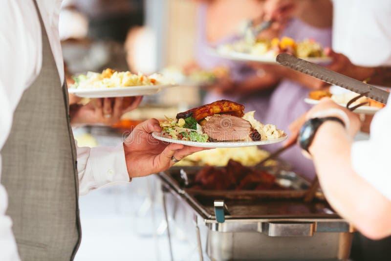 在结婚宴会的充分的菜盘 图库摄影