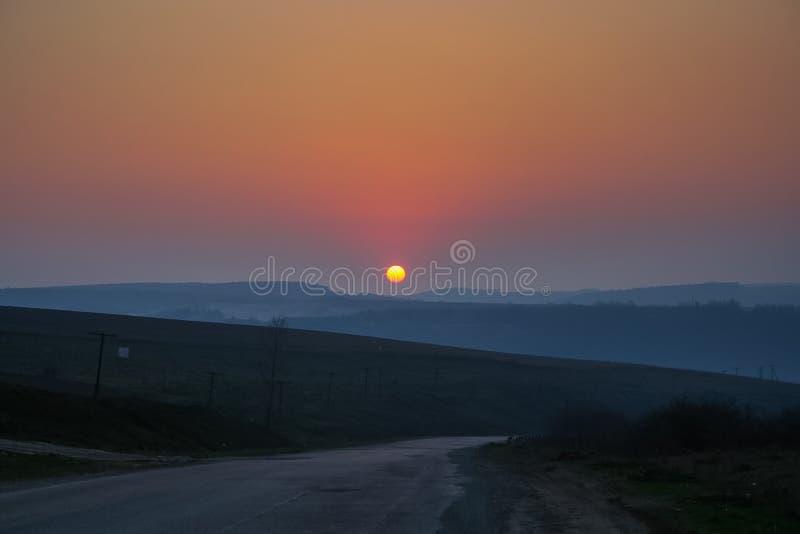 在巴宾平均附近村庄的日落I Kalush区  库存图片