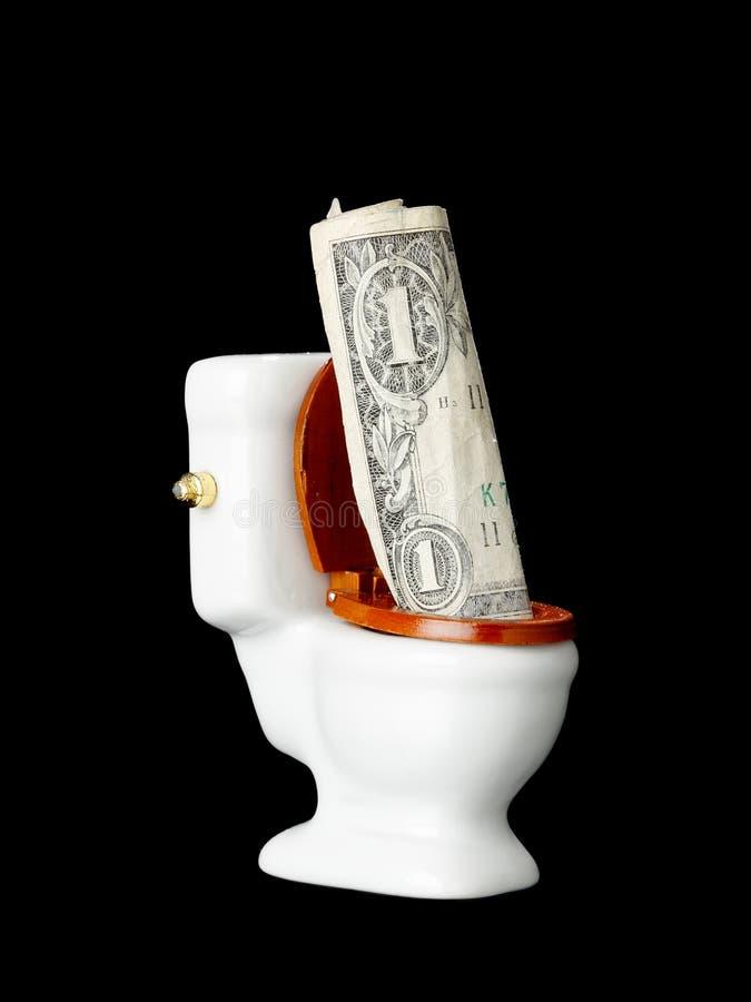 在洗手间下的充足的金钱 免版税库存照片
