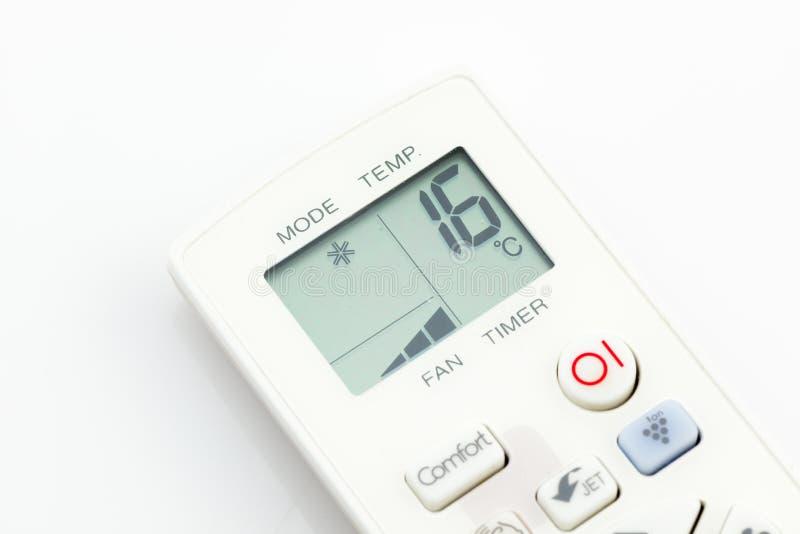 在16摄氏度的遥控空调器被隔绝的 库存图片