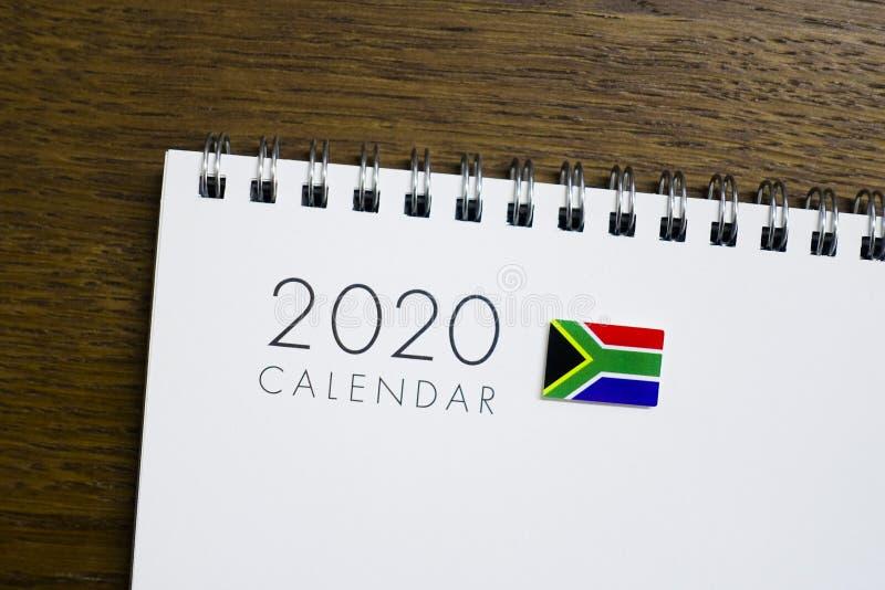在2020日历的南非旗子 库存图片
