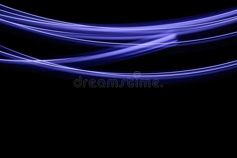 在黑暗的背景的光足迹 图库摄影