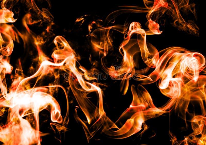 在黑暗的背景的抽象烟 免版税库存图片