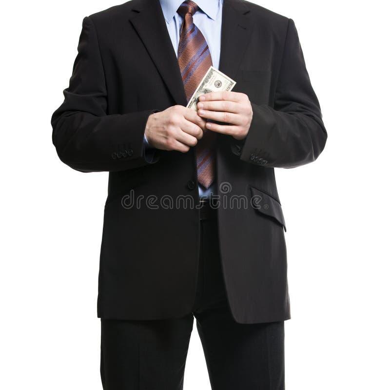 在黑暗的衣服的商人与一束美国美元 免版税库存图片