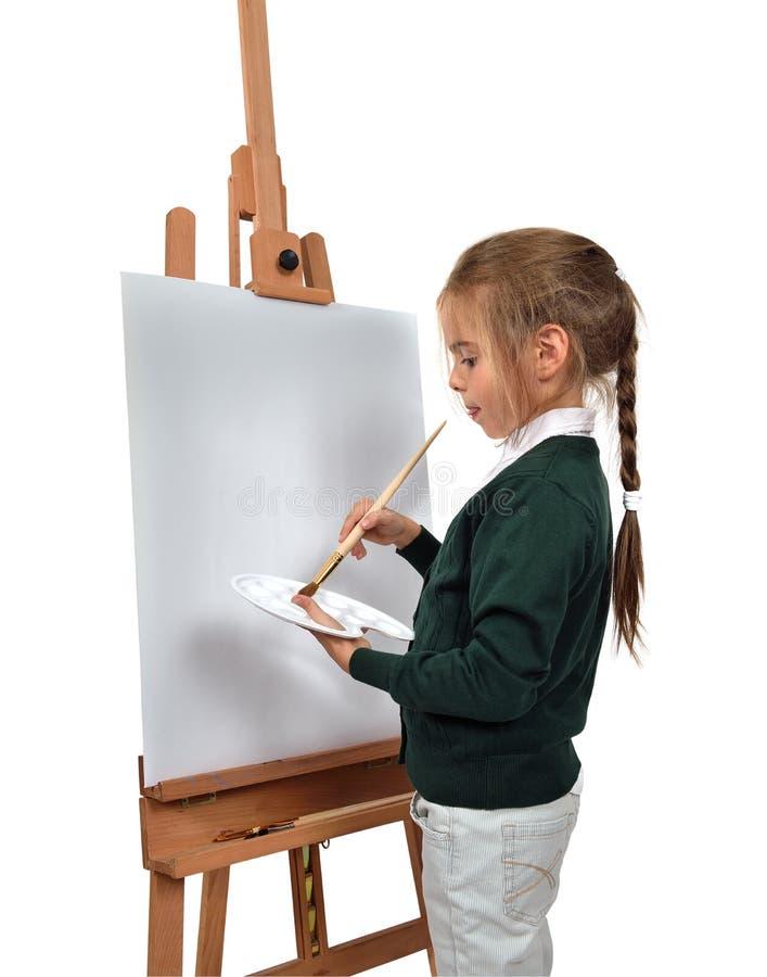 在画架的女孩绘画 库存图片