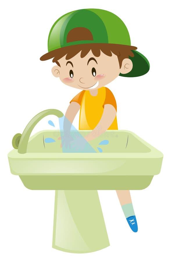 在水槽的男孩洗涤的手 皇族释放例证