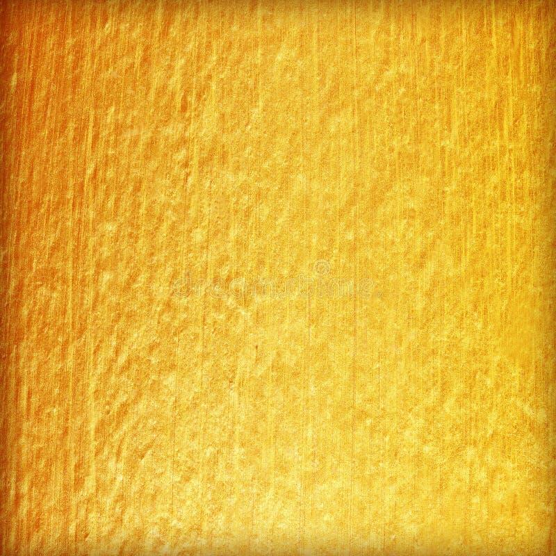 在水泥墙壁纹理的金油漆 背景金黄纹理 库存图片