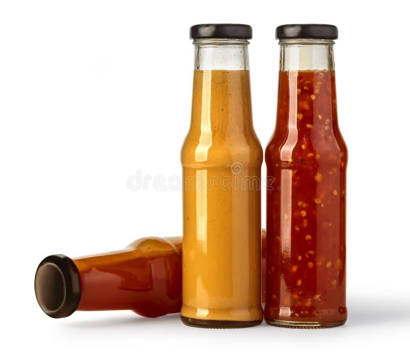 在玻璃瓶的各种各样的烤肉汁 免版税库存图片