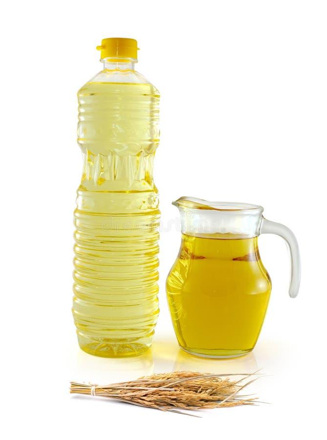 在玻璃瓶的米糠油与种子和麸皮 库存照片