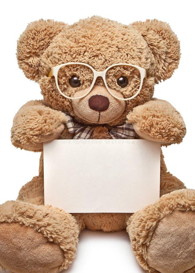 在玻璃的玩具熊与空白的横幅 免版税图库摄影