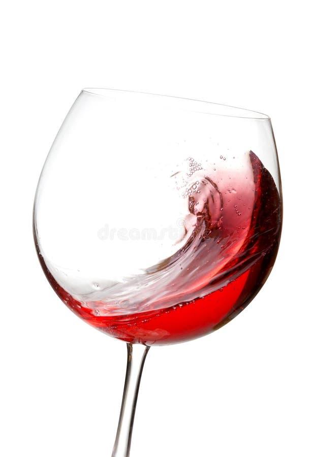 在玻璃的红葡萄酒飞溅 免版税库存图片