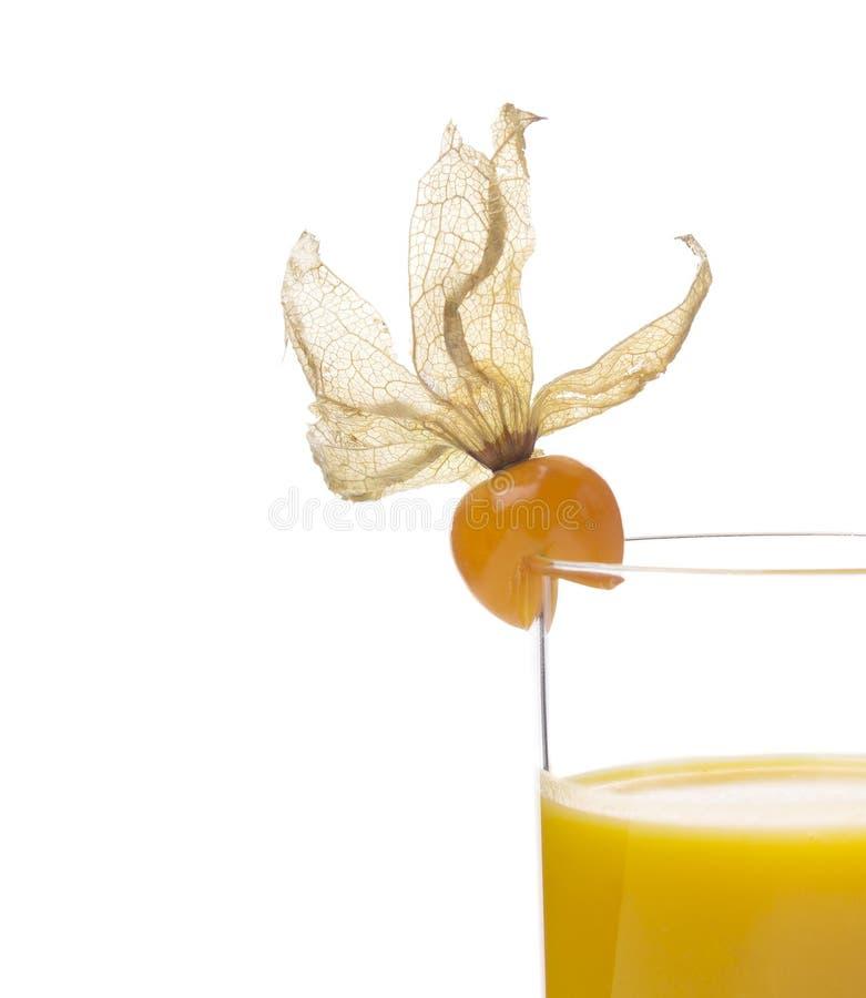 在玻璃的黄色汁液用空泡果子,被隔绝 免版税库存图片